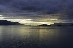 Alaskan Sunset. The sunset leaving Endicott Arm anfter cruising to Dawes Glacier Stock Image
