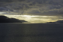 Alaskan Sunset. The sunset leaving Endicott Arm anfter cruising to Dawes Glacier Royalty Free Stock Image