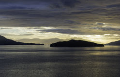 Alaskan Sunset. The sunset leaving Endicott Arm anfter cruising to Dawes Glacier Royalty Free Stock Photos