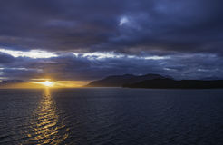 Alaskan Sunset. The sunset leaving Endicott Arm anfter cruising to Dawes Glacier Stock Photography