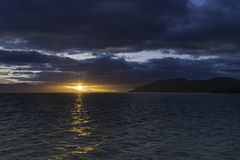 Alaskan Sunset. The sunset leaving Endicott Arm anfter cruising to Dawes Glacier Royalty Free Stock Images