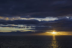 Alaskan Sunset. The sunset leaving Endicott Arm after cruising to Dawes Glacier Royalty Free Stock Image