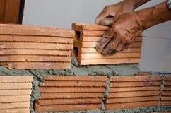Albañilería, construcción de edificios. Imagen de archivo libre de regalías