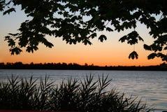 Alba della riva del lago Fotografia Stock