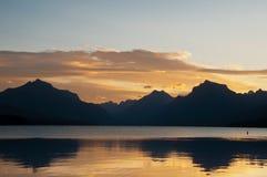 Alba della sosta nazionale del ghiacciaio sopra le montagne Fotografia Stock Libera da Diritti