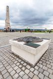 Symbolic bronze map of the city and  granit obelisk at Alba Iuli. ALBA IULIA, ROMANIA - APRIL 30, 2017:Symbolic bronze map of the city and  granite obelisk Royalty Free Stock Images