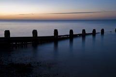 Alba lunga Stunning di esposizione sopra il mare calmo Immagine Stock Libera da Diritti