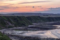 Alba sopra le scogliere di Scarborough, al Nord fotografia stock libera da diritti