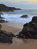Alba su una spiaggia Fotografie Stock Libere da Diritti