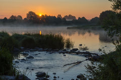 Alba sul fiume Immagine Stock