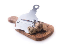 Alba white truffle. Tuber on wood board and truffle's knife Royalty Free Stock Image