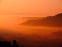Alba wschód słońca w kraju z pomarańcze Obrazy Stock