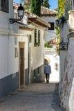 Albaicin in Granada. A man with hat walking through the streets of the Arabian quarter Albaicin in Granada Stock Photo