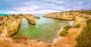 Albandeira beach arc. Albandeira beach is located in the region of Algarve, Portugal. It is one of the beautifull scenic landscapes of the region Stock Images