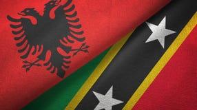Albania, święty i dwa flagi tekstylny płótno, tkaniny tekstura royalty ilustracja