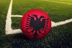 Albania ball on corner kick position, soccer field background. National football theme on green grass.  royalty free stock photos