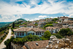 2016 Albania Berat - City of thousand windows, beautifull view of town on the hill between a lot of trees and blue sky Stock Image
