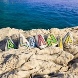 Albania country name on stones, scenery with the sea in the background Royalty Free Stock Photo