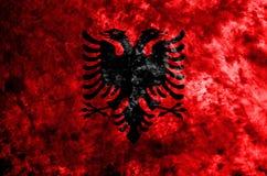 Albania dymu flaga grunge flaga na starym brudzi ścianę Zdjęcie Stock