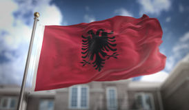 Albania Flag 3D Rendering on Blue Sky Building Background Royalty Free Stock Photography