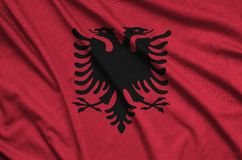 Albania flag is depicted on a sports cloth fabric with many folds. Sport team banner. Albania flag is depicted on a sports cloth fabric with many folds. Sport royalty free stock photos