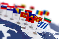 Albania flag in the focus. Europe map with countries flags Stock Photos