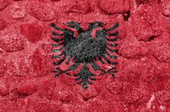 Albania Flag on a stone wall royalty free illustration