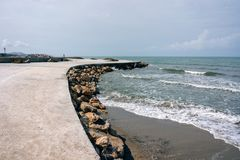 Albania. Golem. The embankment road is flooded with concrete stock photography