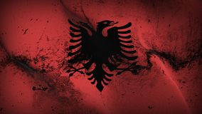 Albania grunge dirty flag waving on wind. Albanian background fullscreen grease flag blowing on wind. Realistic filth fabric texture on windy day Stock Photo