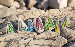 Albania inscription arranged with painted letters on the stones. Albania inscription arranged with colorful painted letters on the stones stock photo