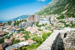 2016, Albania, Kruja. Beautiful view to the city and moutains. Blue sky and green landscape with red roofs of the city. Kruje Stock Image