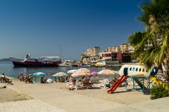 Albania. Saranda - July 16, 2018. Tourists are resting on the beach of the Ionian Sea royalty free stock photos