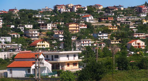 Albania. Typical urban development on the slopes of the hill. Terraced construction of houses on the slopes of the mountains is a landmark of Stock Image