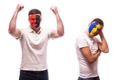 Albania vs Romania on white background. Football fans of national teams demonstrate emotions: Albania – win, Romania – lose. Royalty Free Stock Photos