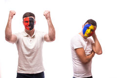 Albania vs Romania on white background. Football fans of national teams demonstrate emotions: Stock Photos