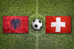 Albania vs. Switzerland flags on soccer field Stock Images