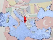 Albania z flaga na kuli ziemskiej Zdjęcie Stock