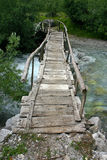 Albanian Alps. Old wooden bridge on the stream stock photo
