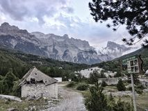 Scenic albanian Alps, Teth. Albanian Alps, dirt road, collapsed stone house royalty free stock photos