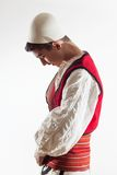 Albanian boy in traditional costume getting dressed Royalty Free Stock Images