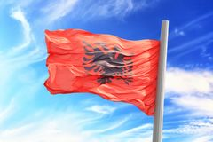 Albanian flag. Flag of Albania against the background of the sky royalty free stock images