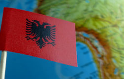 Albanian flag with a globe map as a background Stock Photos