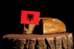 Albanian flag on a stump with bread Stock Photography