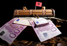 Albanian flag on top of crate. Full of money royalty free stock images