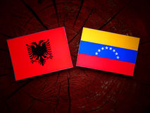 Albanian. Flag with Venezuelan flag on a tree stump stock photos
