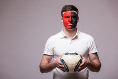 Albanian football fan with ball in game  of Albania national team on grey background. Royalty Free Stock Photography