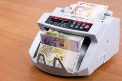 Albanian money in a counting machine. Albanian money - Leke in a counting machine royalty free stock images
