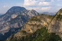 Albanian mountain panorama in warm evening light, between Theth mountain village and the remote Vermosh village, Albania. Panoramic shot of a mountain range stock photography