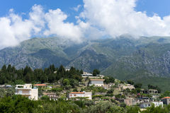Albanian village in front of mountain scenery. A small, traditional Albanian village in front of a beautiful mountain scenery Royalty Free Stock Photos