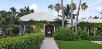 ALBANY, NASSAU. BAHAMAS - JULY 17, 2018. Resort entrance tunnel cover by tropical and exotic plants and ivy stock image